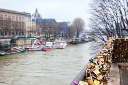 The Seine river and love locks at Pont Neuf in Paris