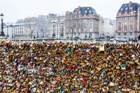 Love locks at Pont Neuf and the city of Paris