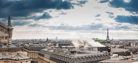 Sun rays over the beautiful Paris City seen from the rooftop of the Lafayette Galeries in a cold winter day