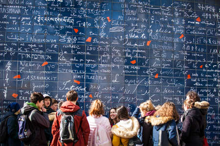 Tourists at the I Love You Wall located at the famous Parisian Montmartre neighborhood in winter