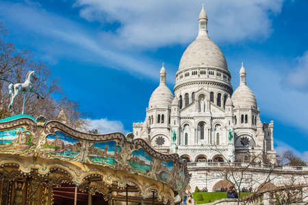Carrousel and the Sacre Coeur Basilica at the Montmartre hill in Paris France