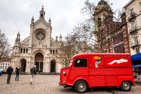 St. Catherines Church and the vintage red food truck in a freezing winter day