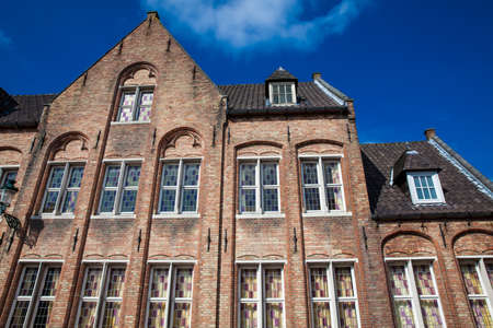 BRUGES, BELGIUM - MARCH, 2018: Houses representative of the traditional arquitecture of the historical Bruges town 에디토리얼
