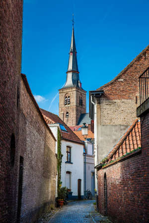 Bicycle and traditional houses at the historic town of Bruges Stock Photo
