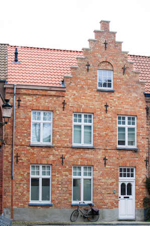 Bicycle and traditional houses at the historic town of Bruges Editorial