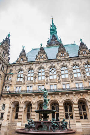 Hygieia fountain in the courtyard of Hamburg City Hall in a cold rainy early spring day Editorial