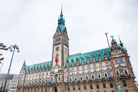 Hamburg City Hall buildiing located in the Altstadt quarter in the city center at the Rathausmarkt square in a cold rainy early spring day