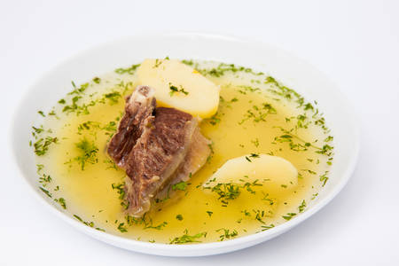 Traditional Colombian beef rib broth isolated on white background 版權商用圖片