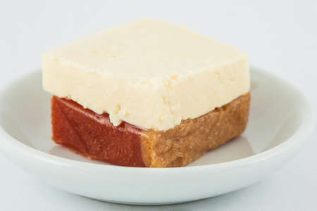 Traditional Colombian sweet from the Velez town in Santander called Bocadillo served with white cheese