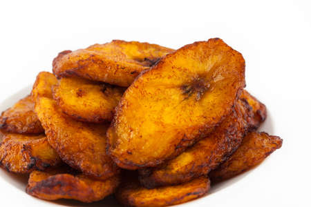 Deep fried ripe plantain slices isolated in white background Stock Photo