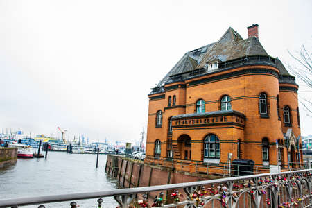 HAMBURG, GERMANY - MARCH, 2018: Love locks at the bridge next to the police station 2 at the Hamburg harbor Editorial
