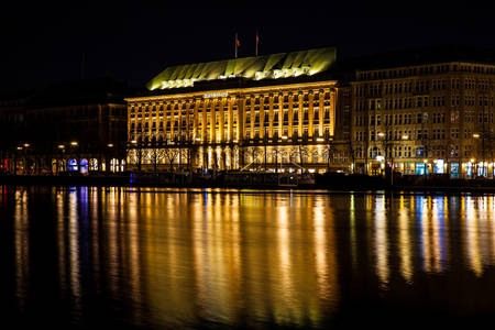 The Headquarters of Hapag-Lloyd located on the Inner Alster Lake shore at night time