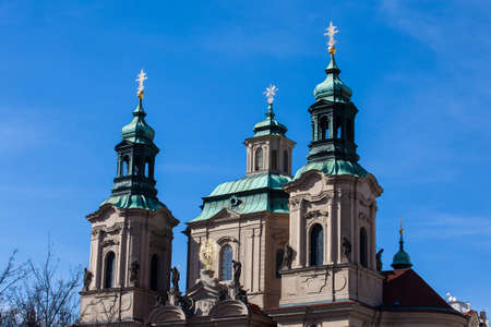 Towers of the St. Nicolas Church located in Prague old town Banco de Imagens