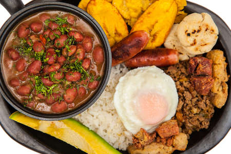 Traditional Colombian dish called Banda paisa: a plate typical of Medellin that includes meat, beans, egg and plantain Banco de Imagens