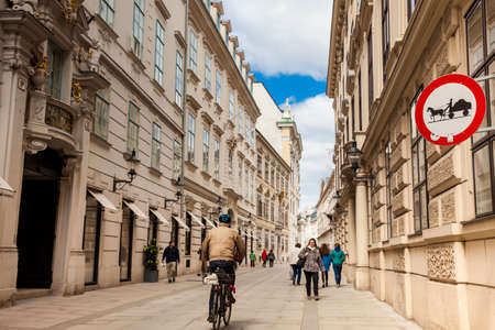 Horse-drawn vehicles likely to be on road sign at a beautiful street in Vienna inner city