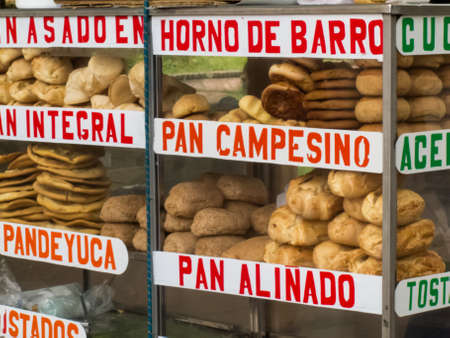 Female street vendor of different types of traditional breads in Cali