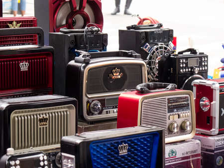 Street sell of vintage style battery operated portable radios at Cali city center