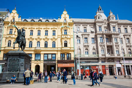 Locations and tourists at Zagreb main square next to the Statue of Count Ban Josip Jelacic
