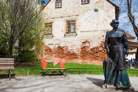 Statue of famous writer Marija Juric Zagorka and sun clock in Zagreb