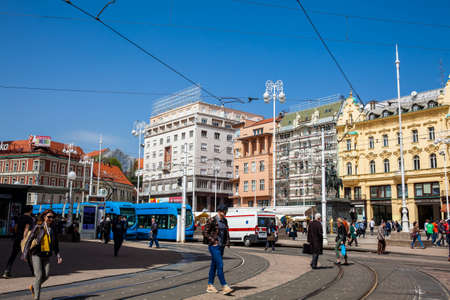 Locals and tourists at Zagreb main square in a beautiful early spring day