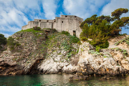 Dubrovnik West Pier and the medieval Fort Lovrijenac located on the western wall of the city