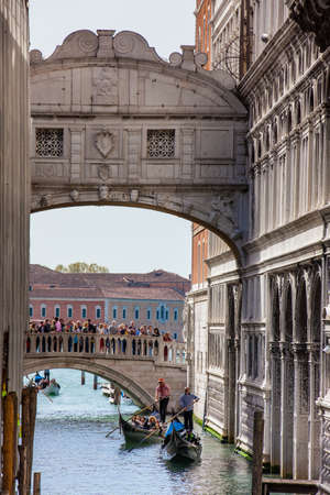 The famous Bridge of Sighs at the beautiful Venice canals Editorial