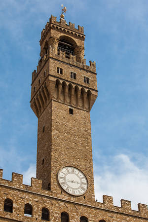 Clock tower of the Palazzo Vecchio built at the Piazza della Signoria in the 12th century in Florence