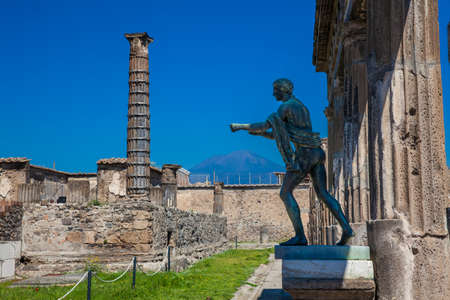 Ruins of the ancient Temple of Apollo with bronze Apollo statue in Pompeii