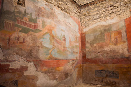Ancient paintings decorationg the walls of the city of Pompeii