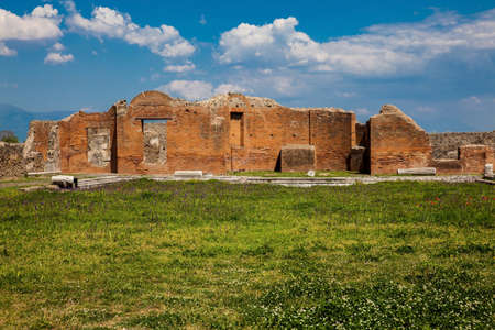 Ruins of the Building of Eumachia in the ancient city of Pompeii in a beautiful early spring day