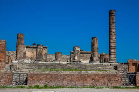 Temple of Jupiter at the Forum of the Ancient City of Pompeii in a beautiful early spring day Stock Photo