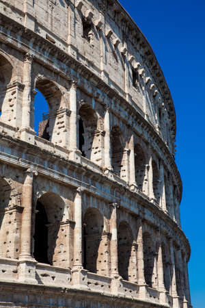 Detail of the famous Colosseum or Coliseum also known as the Flavian Amphitheatre in the centre of the city of Rome Фото со стока