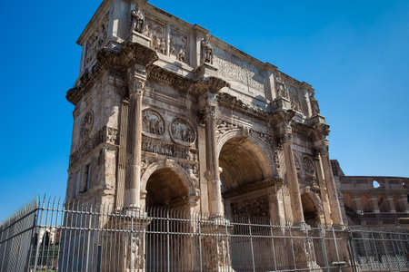 The Arch of Constantine a triumphal arch in Rome, situated between the Colosseum and the Palatine Hill built on the year 315 AD Фото со стока