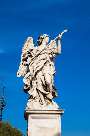 Beautiful Angel with the Lance statue created by Domenico Guidi on the 16th century at Sant Angelo Bridge in Rome