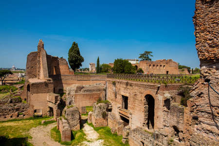 ROME, ITALY - APRIL, 2018: Tourists visiting the ruins of the Palace of Septimius Severus or Domus Severiana on the Palatine Hill