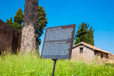 ROME, ITALY - APRIL, 2018: Informative sign at the Nymphaeum and Adjoining Cisterns at the Palatine Hill in Rome