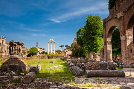 ROME, ITALY - APRIL, 2018: Remains of the Basilica Julia and the Temple of Castor and Pollux at the Roman Forum in Rome Редакционное