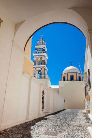 Bell tower and dome of the Saint John the Baptist church in the city of Fira in the Island of Santorini