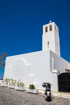 Bell tower of the parish church of St. Gerasimos located in Fira of Santorini