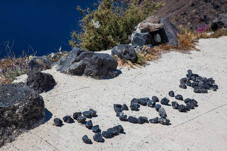 I love you sign made of rocks at the walking trail number 9 between the cities of Fira and Oia in the Santorini Island