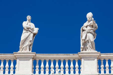 Detail of the statues of saints that crown the colonnades of St. Peter Square built on 1667 on the Vatican City
