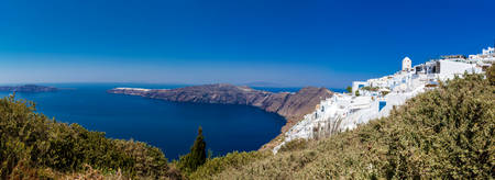 Panoramic view of Imerovigli village, the Aegean sea and Oia city from the walking trail number 9 between the cities of Fira and Oia at Santorini Island