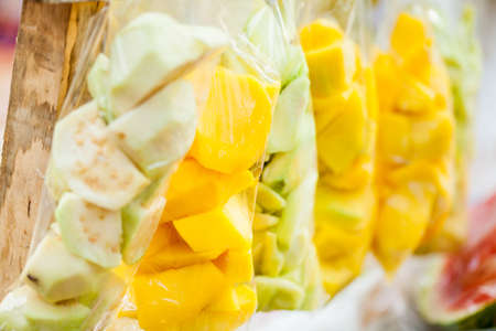 Close up of bags of mango and guava pieces
