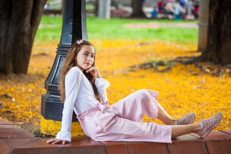 Beautiful young girl sitting at the Paseo Bolivar Square at Cali city center in Colombia