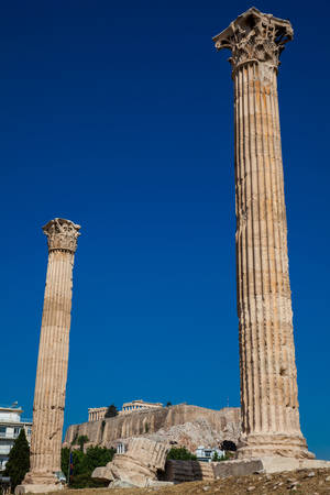 Ruins of the Temple of Olympian Zeus also known as the Olympieion and the Acropolis at the center of the Athens city in Greece