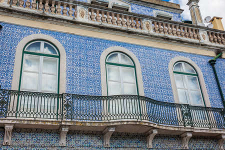Traditional architecture of the facades covered with ceramic tiles called azulejos in the city of Lisbon in Portugal Stock Photo