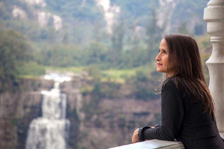 Female tourist visiting the famous Tequendama Falls located southwest of Bogotá in the municipality of Soacha