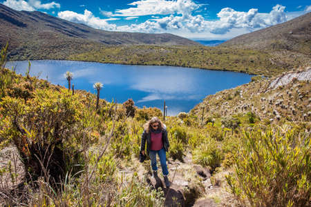 Young woman exploring the nature of a beautiful paramo at the department of Cundinamarca in Colombia