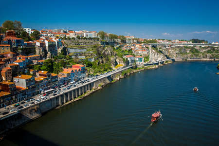 Boats sailing on the Douro River in a beautiful early spring day