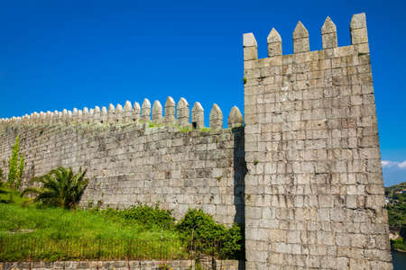 Detail of the Fernandine Walls of Porto located next to the Dom Luis I Bridge in a beautiful sunny day